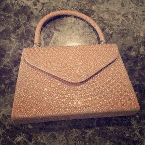A rose gold sparkly purse